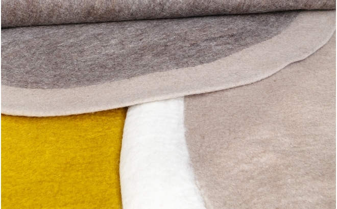 round yellow felt rug